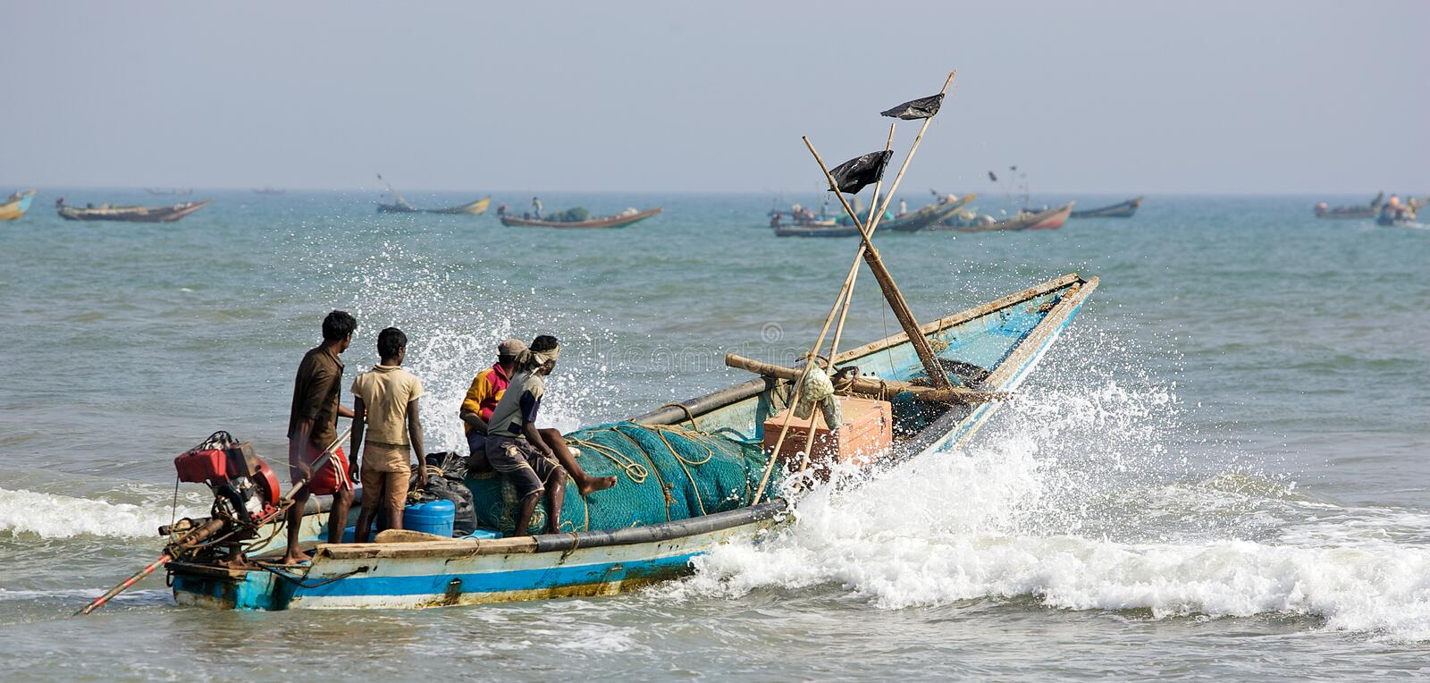 Indian fisherman and boat stock photography