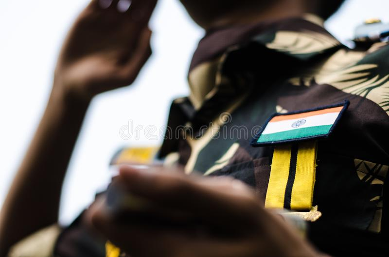 Soldier wearing an uniform with indian national flag stock image