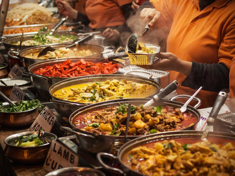 Indian food. Takeaway Indian food at London market stock images