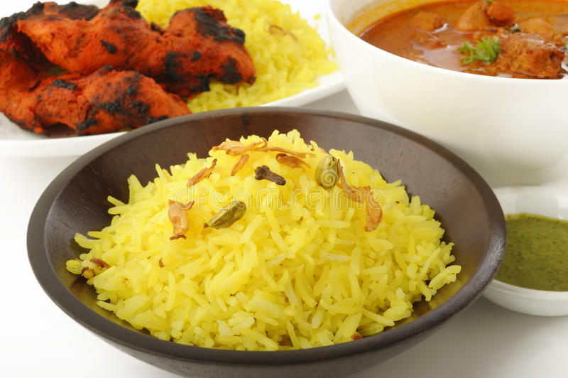 Indian food. Chicken Tikka Masala , Tandoori chicken tikka with pilau rice stock images
