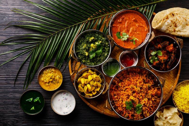 Indian food Curry butter chicken, Palak Paneer, Chiken Tikka, Biryani, Vegetable Curry, Papad, Dal, Palak Sabji, Jira Alu stock images