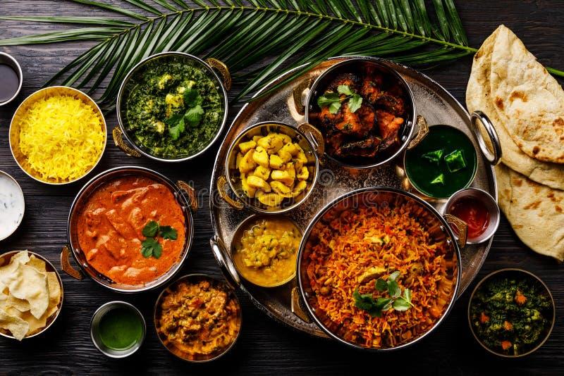 Indian food Curry butter chicken, Palak Paneer, Chiken Tikka, Biryani, Vegetable Curry, Papad, Dal, Palak Sabji, Jira Alu royalty free stock images