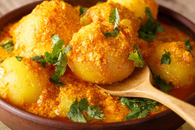 Indian food: Dum aloo potatoes in a curry sauce close-up. horizontal stock images