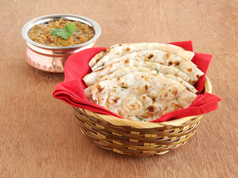 Indian food Kulcha. A type of traditional and popular bread, and vegetable curry royalty free stock photography