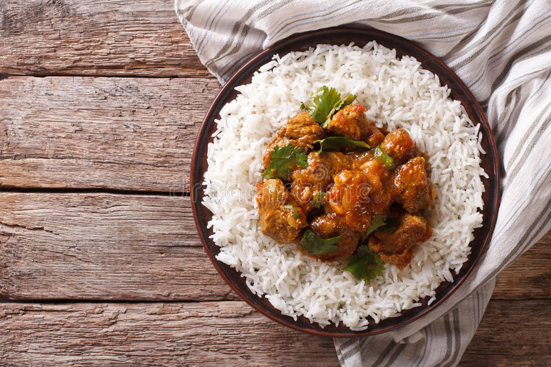 Indian food: Madras beef with basmati rice. Horizontal top view royalty free stock photography