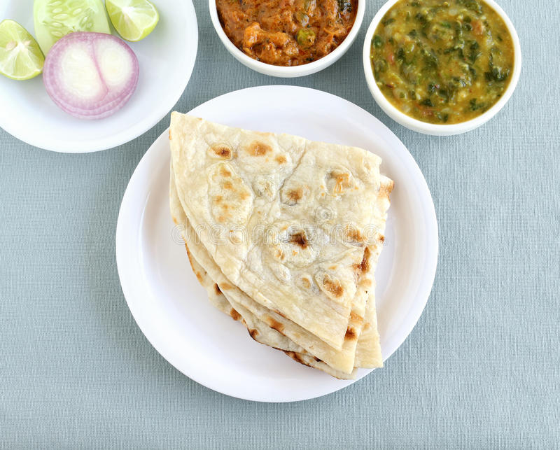 Indian food Naan. A type of traditional and popular bread, and vegetable curries royalty free stock photos