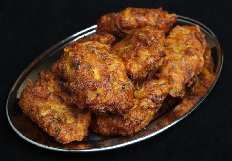 Indian Food, Onion Bhaji. Indian Onion Bhajis on stainless steel tray royalty free stock images