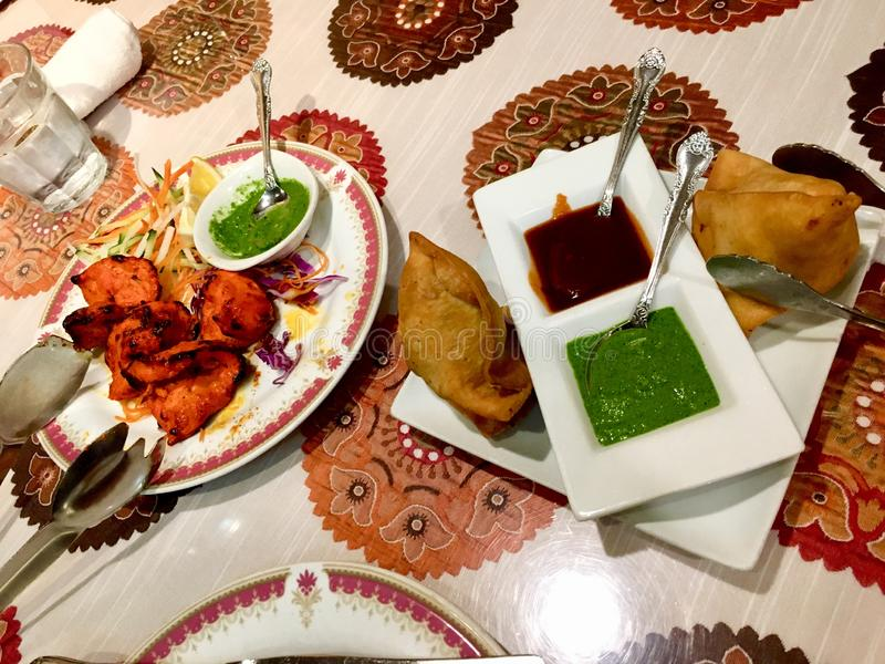 Indian food samosa and tikka chicken royalty free stock images