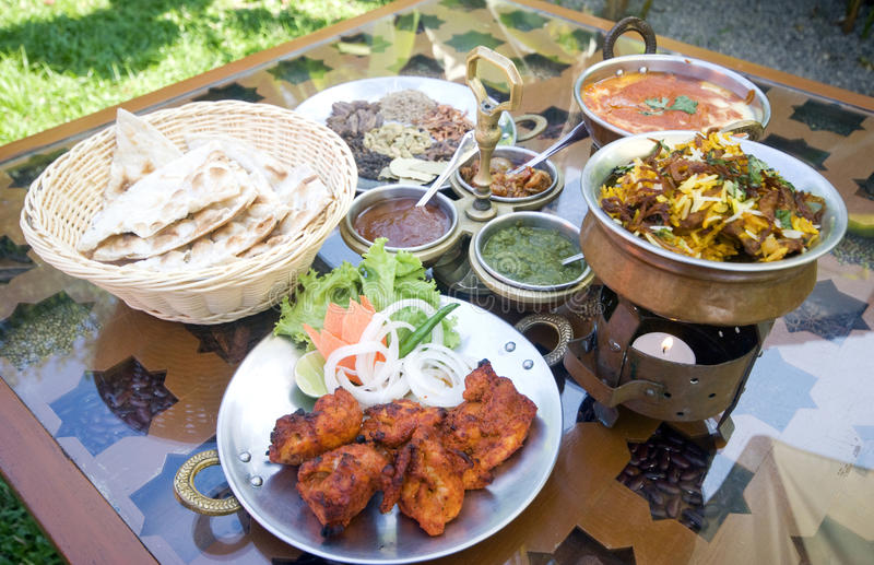 Indian Food. Selection of Indian food including tandoori chicken, nan, tikka and dipping stock image