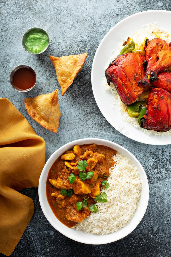 Indian food on the table. Curry,tandoori chicken and samosas royalty free stock photo