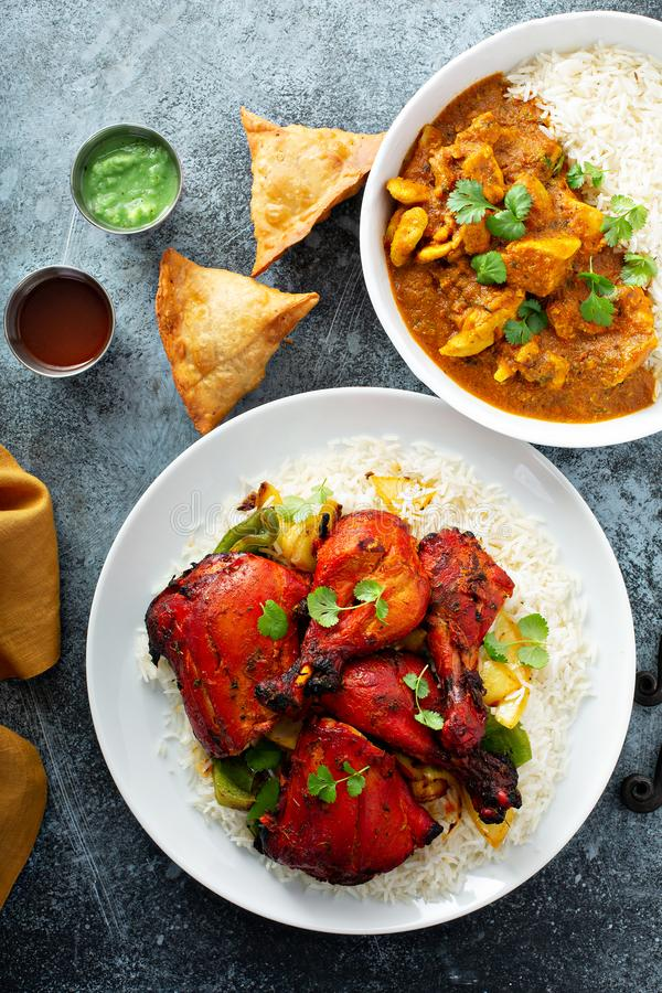 Indian food on the table. Curry,tandoori chicken and samosas stock photography