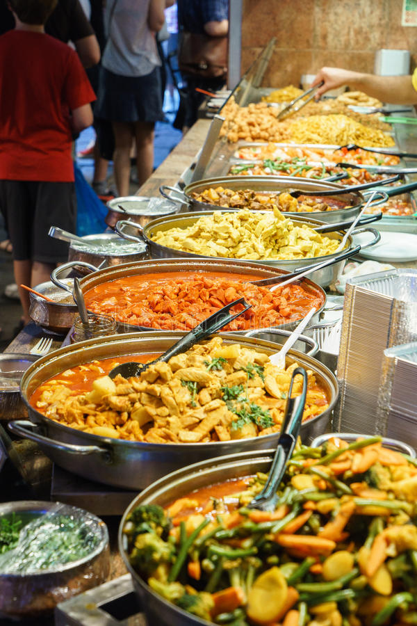 Indian food. Takeaway Indian food in Camden Town Market, London. One of the biggest street market in London, United Kingdom. Photo taken on: Juillet 03rd, 2015 stock photo
