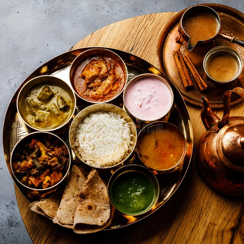 Indian food Thali Indian-style meal with chicken meat and Masala tea Chai royalty free stock image