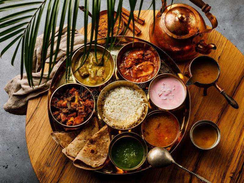 Indian food Thali Indian-style meal with chicken meat and Masala tea Chai royalty free stock photography