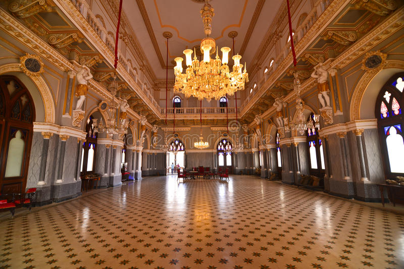 Indian ball room at a Palace. Decorated chandeliers in Indian durbaar of ancient palace of Gujarat. Hall was used for meetings and ballroom dances stock photo