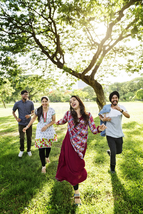 Indian Friends Cheerful Park Concept royalty free stock photography