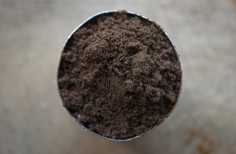 Indian Garam Masala Spice in a round container royalty free stock image