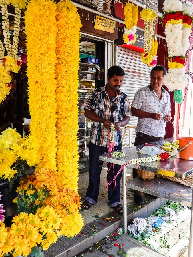 Indian Garland making in Little India Town. Klang / Malaysia - March 03 2017: Indian Garland making in Little India Town. Selective focus marigold asia asian royalty free stock photography