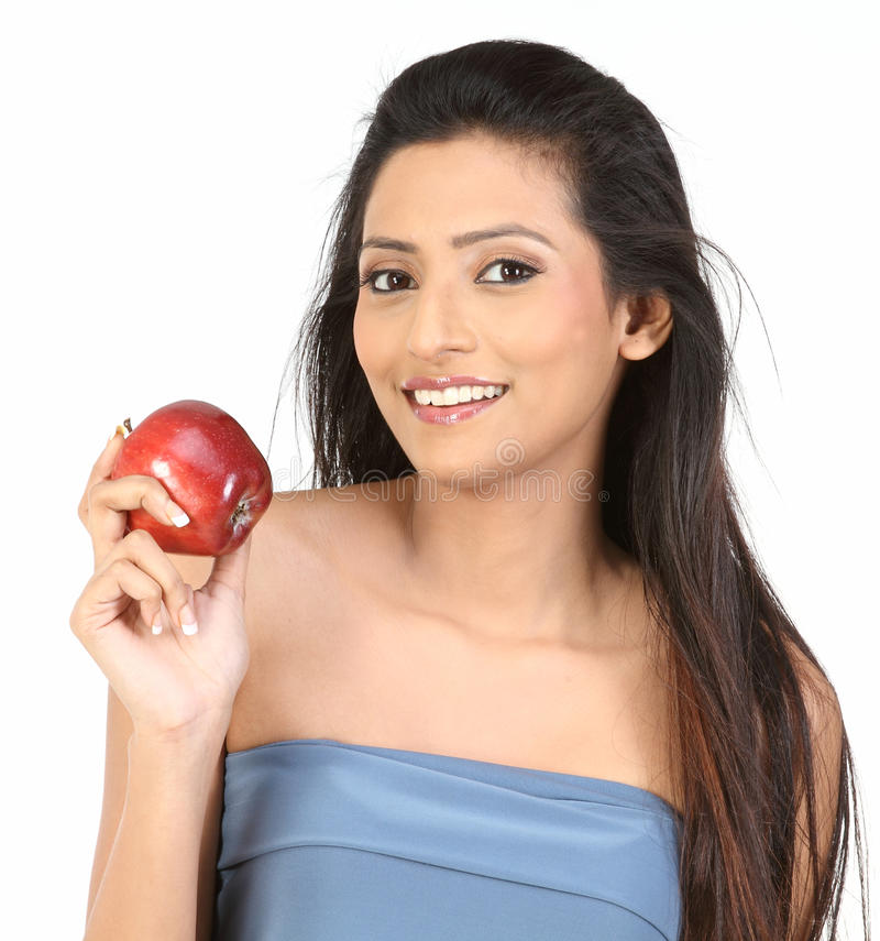 Download Indian girl with apple stock photo. Image of costume - 12379396