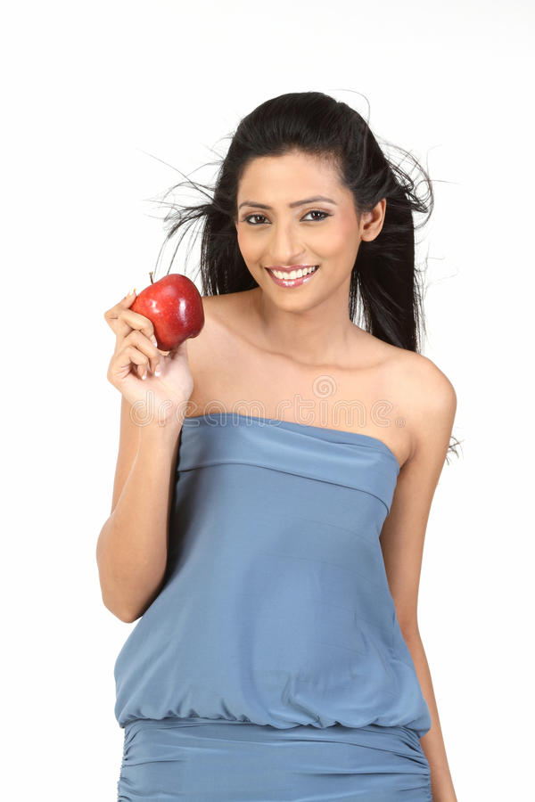 Indian Girl With Apple Royalty Free Stock Photography