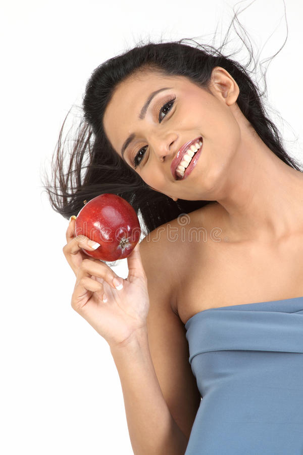 Indian Girl With Apple Stock Photography