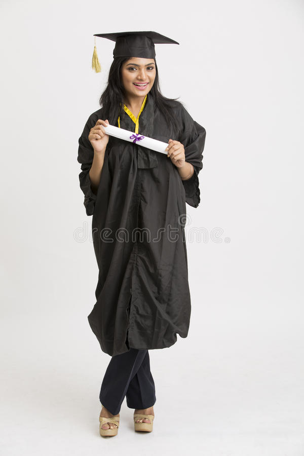 Indian Girl College Graduate Wearing Cap And Gown Holding Diploma ...