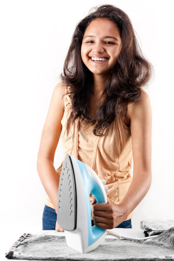 Download Indian Girl And Electric Steam Iron Stock Photography - Image: 17717652