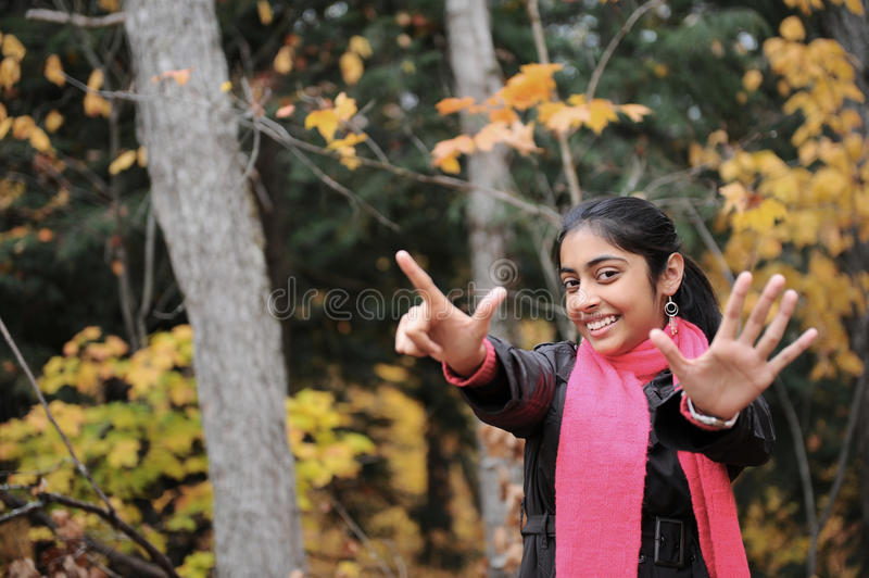 Download Indian Girl in Fall Season stock photo. Image of leaf - 27277948