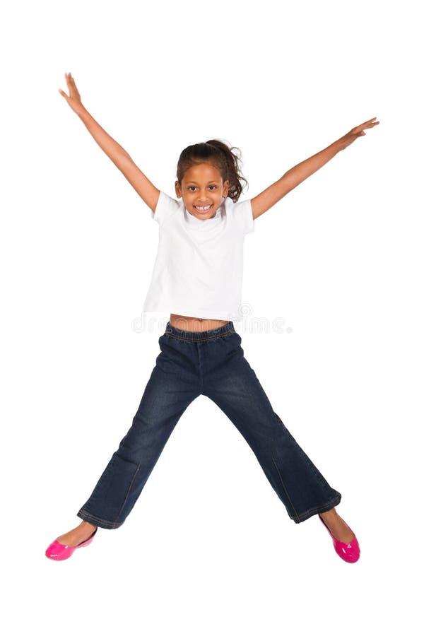 Indian Girl Jumping Stock Photo