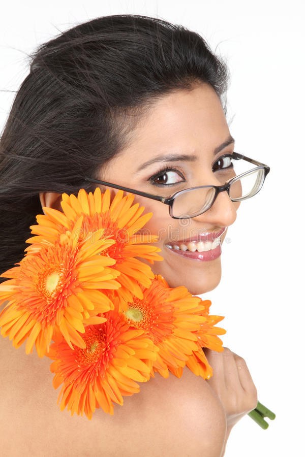 Indian girl with orange daisy flowers royalty free stock photos