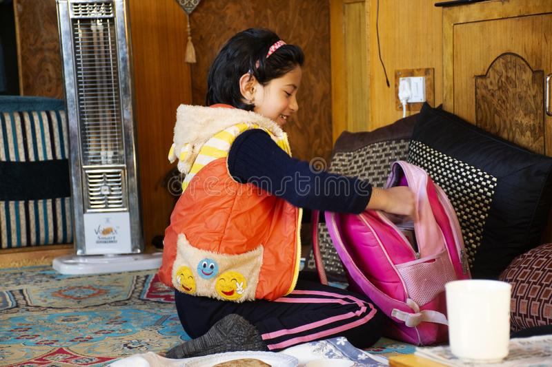 Indian girl people sitting and eating breakfast in living room of guest house at Leh Ladakh village in Jammu and Kashmir, India royalty free stock photos