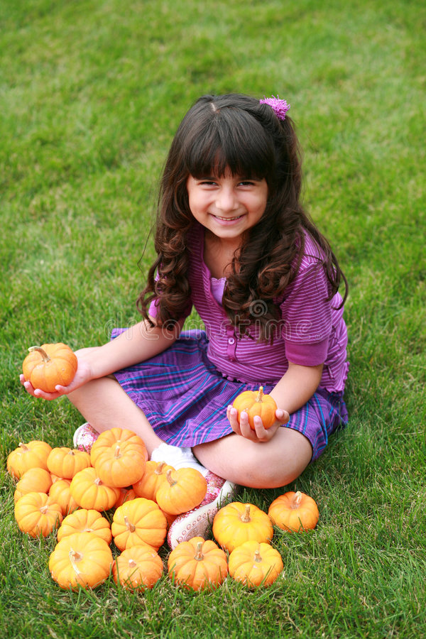 Indian girl and pumpkins royalty free stock images