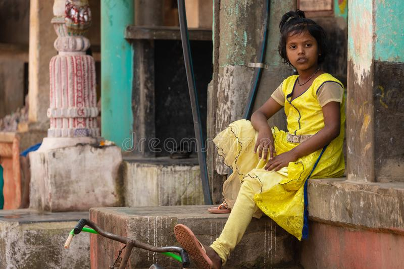 Indian girl sitting in a village stock images