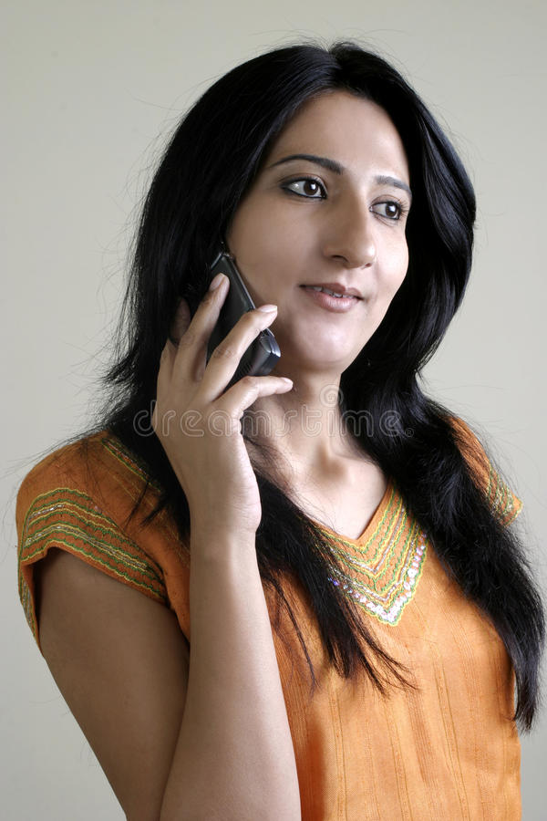 Indian girl using mobile phone