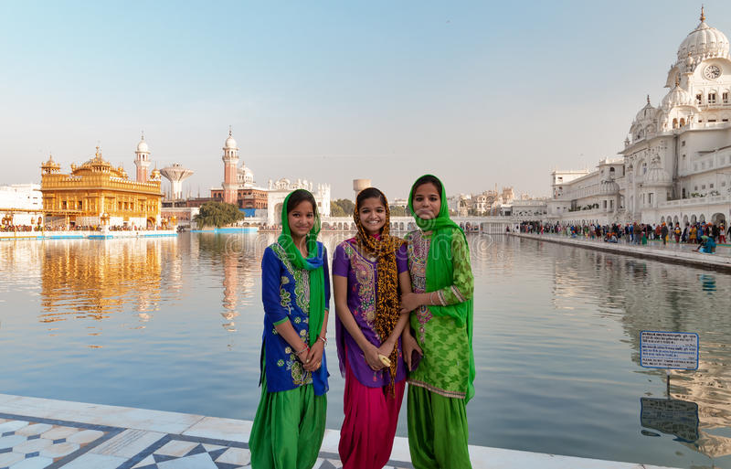 Indian girls in Golden Temple. Amritsar. India. AMRITSAR, INDIA, DEC - 7, 2014: Unidentified Indian girls in Golden Temple (Harmandir Sahib also Darbar Sahib) royalty free stock images