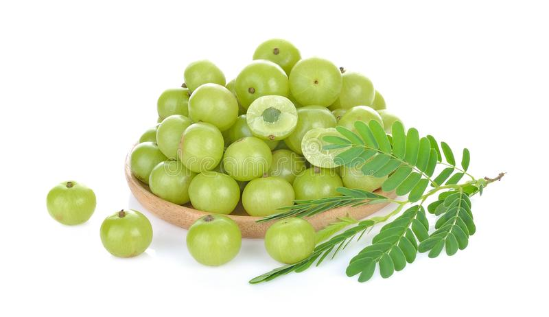 Indian gooseberry in wood bowl on white background stock photography