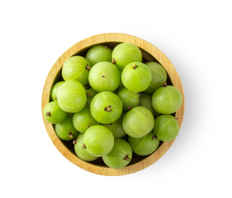 Indian gooseberry in wood bowl on white. Background. top view stock images