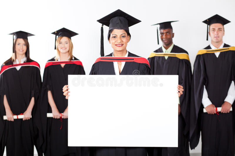 Indian graduate holding white board stock photo