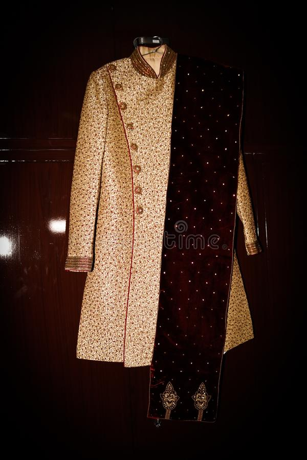 Indian groom wedding Sharwani dress and Khussa shoes stock image