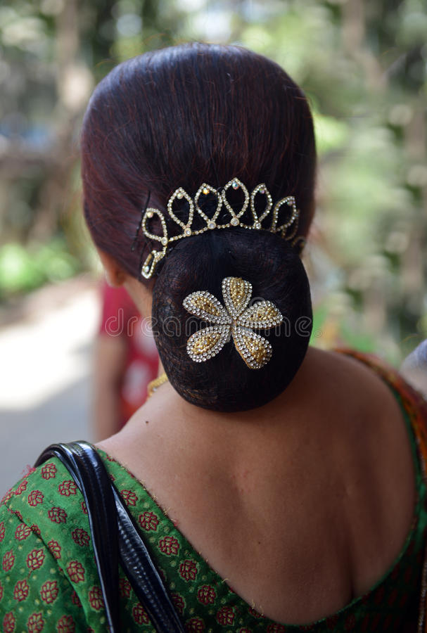 Indian Hair Style - Bun. In every Wedding Indian women comes with different Hair styles to attend marriage ceremony..with fancy flowers stock images