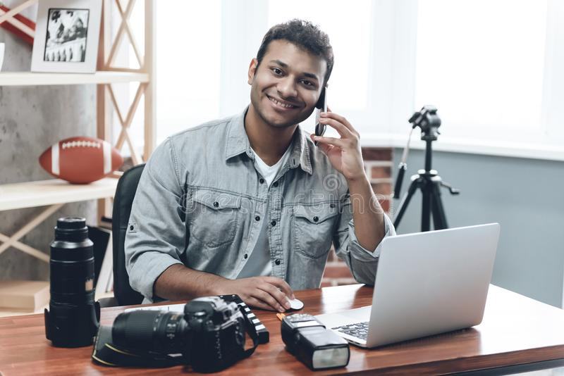 Indian Happy Young Man Photographer Work from Home stock photo
