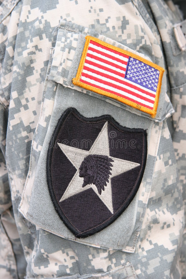 Indian Head and flag patch on army soldier uniform stock photos