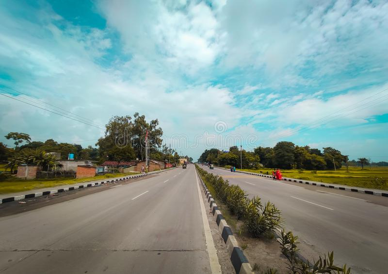 Indian Highway four lane road picture with blue sky above royalty free stock photography