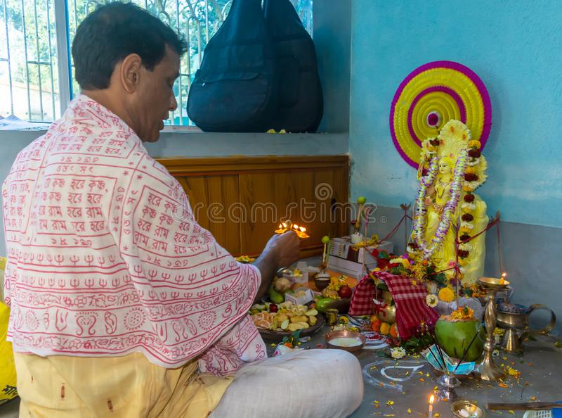 Indian Hindu Brahmin priest worshiping Goddess saraswati. Gobardanga,West Bengal,India-February 10,2019:Indian Hindu Brahmin priest worshiping Goddess saraswati stock photo