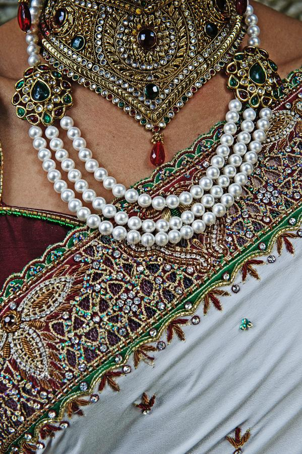 Indian Hindu Brides sari, necklace jewelry and close up of chest. At a traditional Indian wedding royalty free stock photos