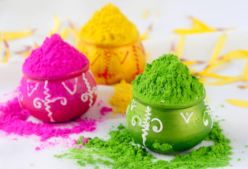 Indian holi colors. Indian Holi festival colors decorated on small pots royalty free stock images