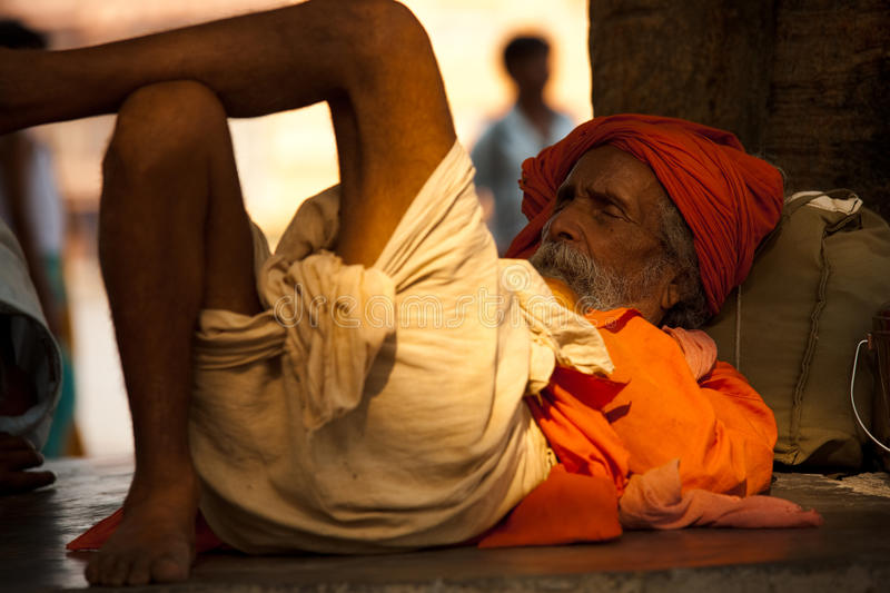 Indian Holy Man Sleeping. Haridwar, India - May 21: A sadhu naps under a shady tree May 21, 2009 in Haridwar, India royalty free stock photo