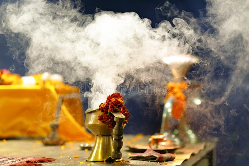 Indian incense smoke and French Marigold flowers stock photo