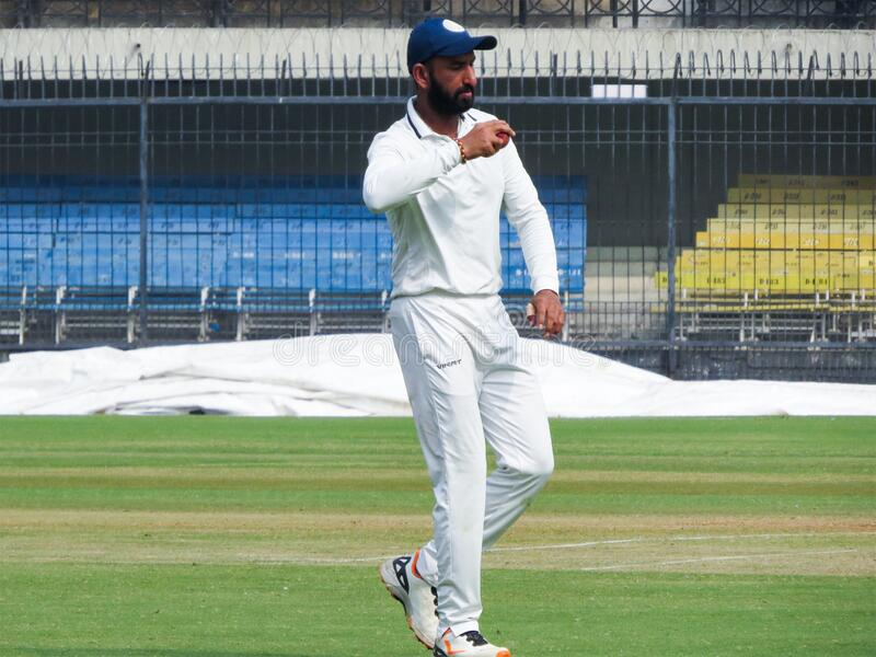 Cricket Player Cheteshwar Pujara Photograph During a match. Indian International sportsman player Cheteshwar Pujara in White Uniform. Pujara is a Right-Handed royalty free stock photography