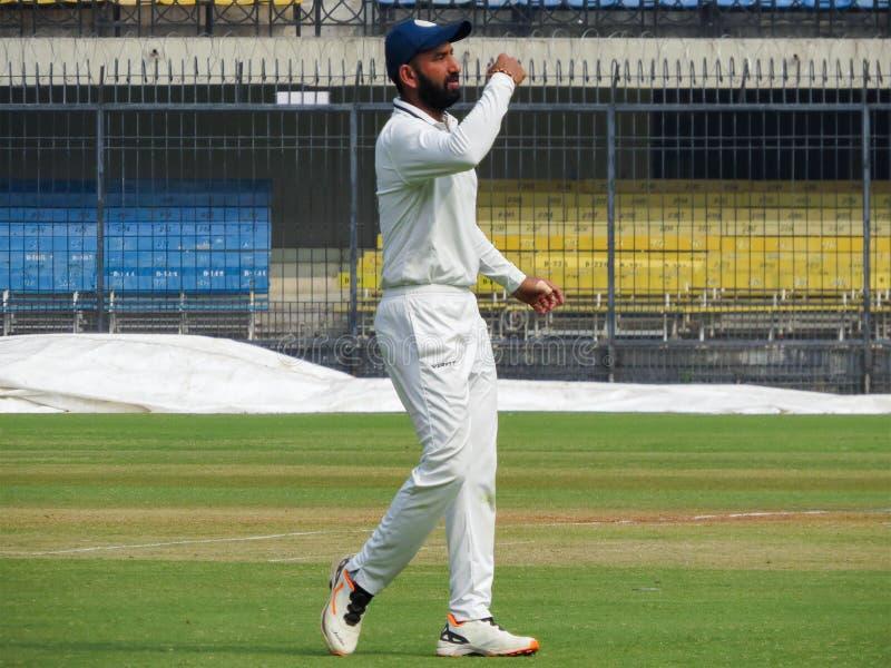 Cheteshwar Pujara Cricketer India. Indian International sportsman player Cheteshwar Pujara in White Uniform. Pujara is a Right-Handed Batsman and he bowls Right stock photos